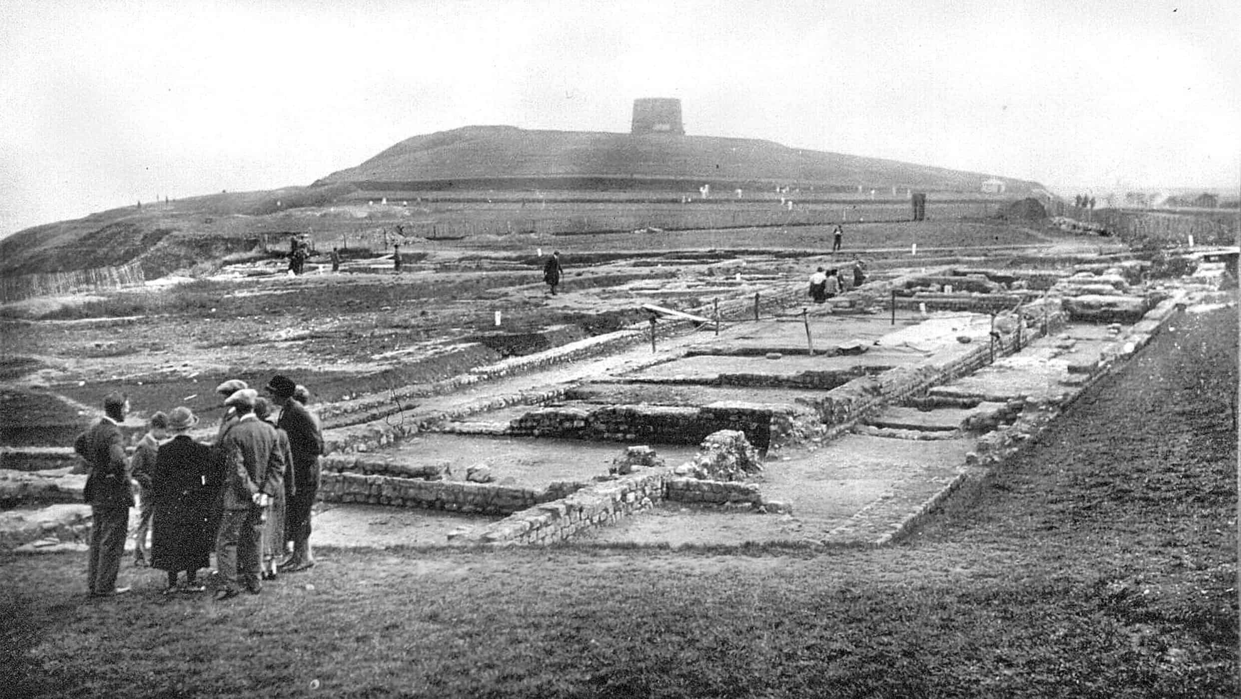 Romans 0c 1924 visitors have a tour - looking across the Roman Villa to Copt Point the Martello Tower