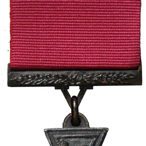 Victoria Cross (VC).  The premier award for gallantry, the VC may be awarded to all ranks of the services and civilians for gallantry in the presence of the enemy. It may be awarded posthumously.  Description: A cross pattŽe in bronze. The obverse of the medal (shown here) bears a lion statant gardant on the royal crown, with the words 'FOR VALOUR' on a semi-circular scroll.  The reverse bears a circular panel inside which is engraved the date of the act for which the decoration was awarded. The reverse of the suspender is engraved with the rank, name and ship, regiment or squadron of the recipient.  Clasp.  A bronze bar ornamented with laurels may be issued to VC holders performing a further act of such bravery which would have merited award of the VC.  Ribbon.  Plain crimson.  Prior to 1918, a dark blue ribbon had been issued for the Royal Navy. When the ribbon alone is worn a replica of the cross in miniature is affixed to the centre of the ribbon.  History.  Instituted by Queen Victoria to cover all actions since the outbreak of the Crimean War in 1854, the Victoria Cross has been awarded 1356 times and 3 bars have been awarded.  The VC is made from the bronze of Russian guns captured at Sebastopol, though modern research suggests that Chinese guns may have been used at various times.