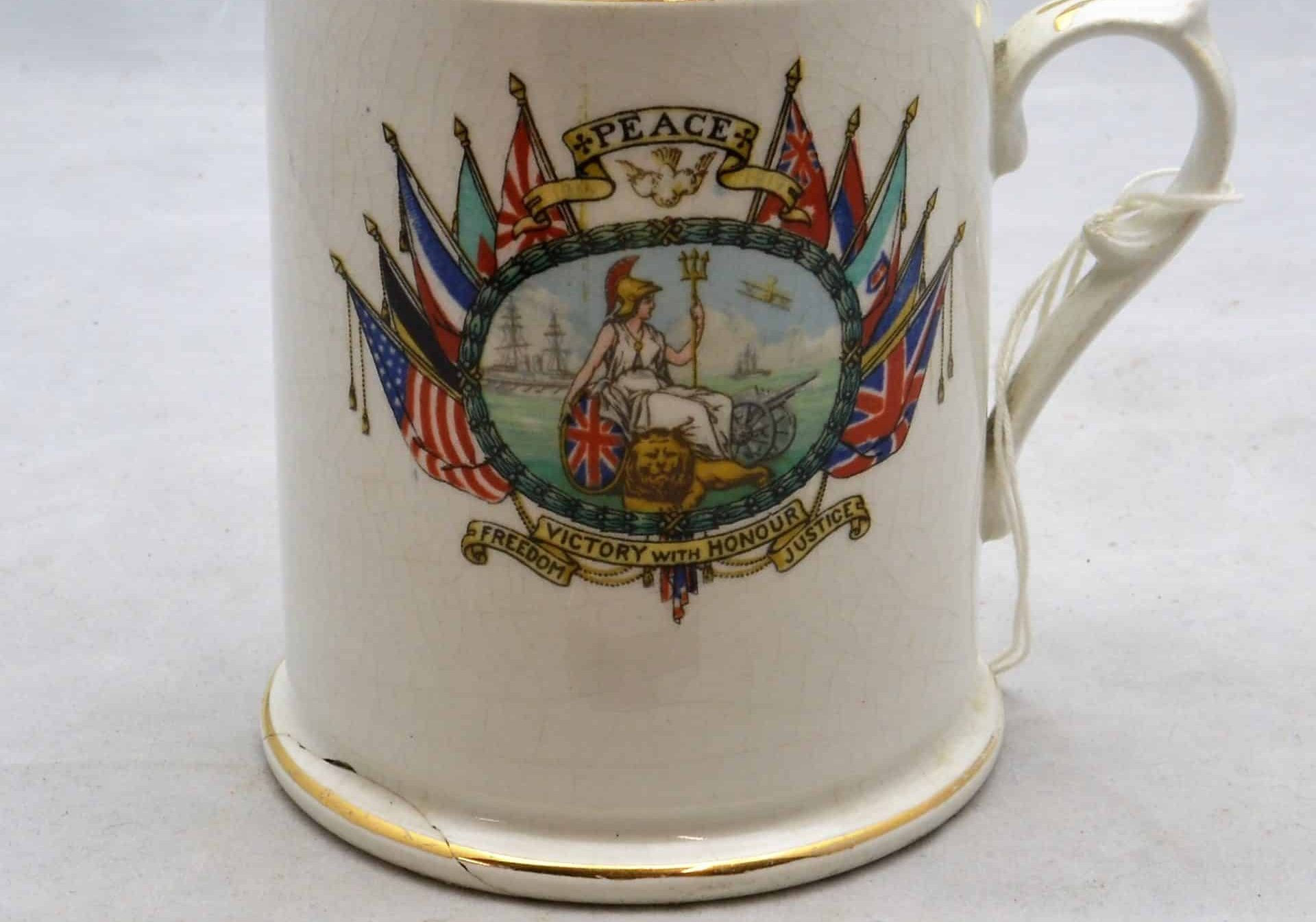 WW1 12 F7682 Mug - depicting Brititania + Lion Peace Victory with Honour, Freedom, Justice